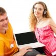 Young man and woman using a laptop — Stock Photo #6007422