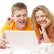 Young man and woman using a laptop — Stock Photo
