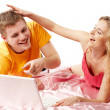Young man and woman using a laptop — Stock Photo #6007433
