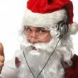 Santa listens to music in ear-phones — Stock Photo #6007528