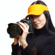Stock Photo: Female photographer shooting you