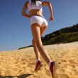Royalty-Free Stock Photo: Woman jogging on sand