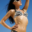 Bikini model in fashionable beachwear and sunglasses — Stock Photo