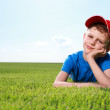 Smiling boy in grass — Stock Photo #6007666