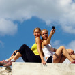 Girls photograph themselves on a mobile phone — Stock Photo