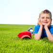 Smiling boy in grass — Stock Photo #6007691