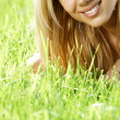 Stock Photo: Smiling teenager in field