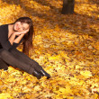 Having rest on autumn leaves of maple  in park — Stock Photo