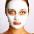 Woman's face in cosmetic mask — Stock Photo