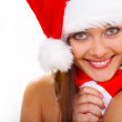 Attractive smiling woman in Santa Cap — Stock Photo