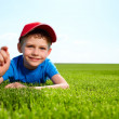 Smiling boy in grass — Stock Photo #6039632