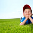 Smiling boy in grass — Stock Photo #6039685