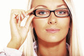 Blond teen holding eyeglasses — Stock Photo