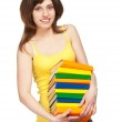 Happy young girl with books — Stock Photo