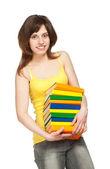 Glad ung flicka med böcker — Stockfoto