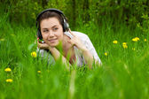 Young girl with headphones looking right — Stock Photo