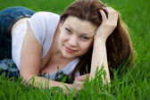 Woman lying in the grass — Stock Photo