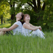 Stock Photo: Sisters relax in park after fitness
