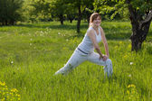 Happy woman doing fitness in a park — Stock Photo