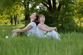 Sisters relax in a park after fitness — Stock Photo