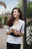 Young realtor near house — Stock Photo