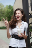 Happy business woman with coffee and notebook — Stock Photo