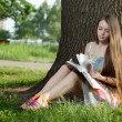 图库照片: Teenager in park with notebook