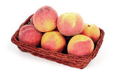 Peaches in basket — Stock Photo