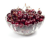 Sweet cherries in glass plate — Stock Photo
