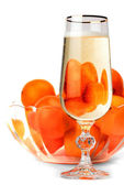 Snifter of champagne with tangerines — Stock Photo