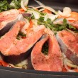 Stock Photo: Salmon steaks with vegetables on cook griddle