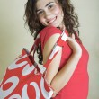 Beautiful young woman with red bag. - Stock Photo