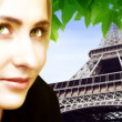 Blond woman and Eiffel Tower - Stockfoto