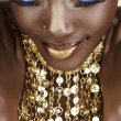African woman with gold — Stock Photo