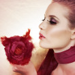 Beautiful woman with rose. — Stock Photo