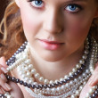 Blond woman in pearls. - Stock Photo
