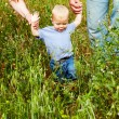 Family of three in the field — Stock Photo