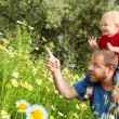 Father and son in flowers — Stock Photo #5396398