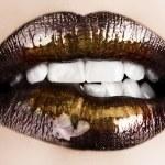 Black gold lips biting. — Stock Photo #5396419