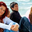 Group of young friends on the beach — Stock Photo
