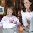 Mother and daughter with laptop — Stock Photo #5396463