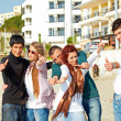 Royalty-Free Stock Photo: Turkish students showing thumbs up on the beach .