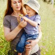 Grandmother and grandson in the green grass — Stock Photo