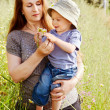 Grandmother and grandson in the green grass - Stock Photo