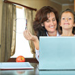 Mother helping her daughter with home work — Stock Photo
