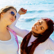 Two student girls at the sea. — Stock Photo