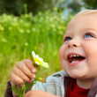 Royalty-Free Stock Photo: Small baby laughing with daisy