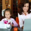 Mother and daughter with laptops — Stock Photo #5396622