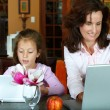Stock Photo: Mother and daughter with laptops