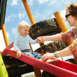 Stock Photo: Grandmother and grandson on the playground